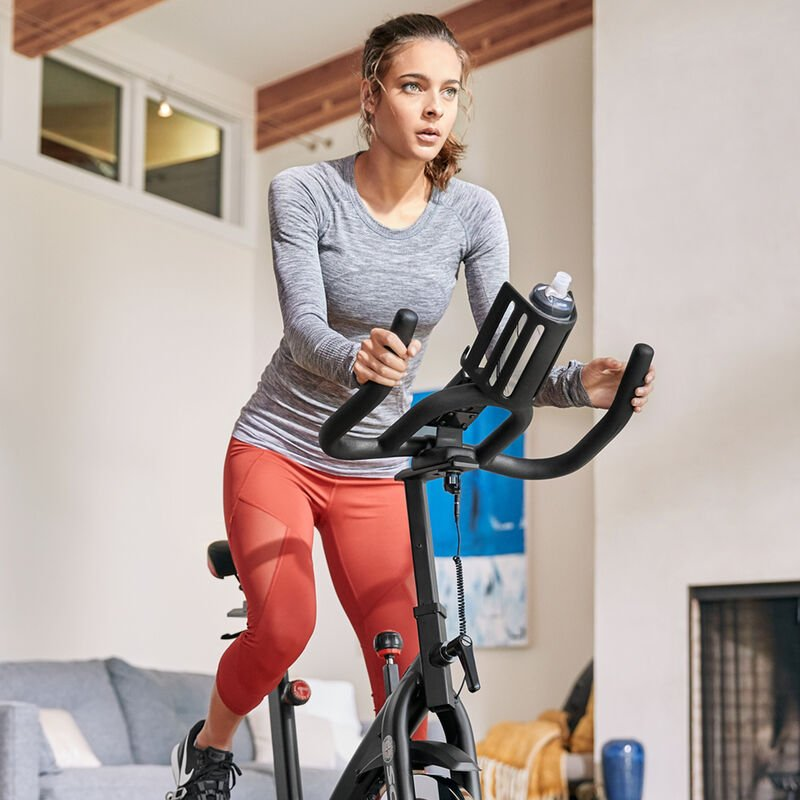 Woman exercising on a Schwinn IC3 Bike - expanded view