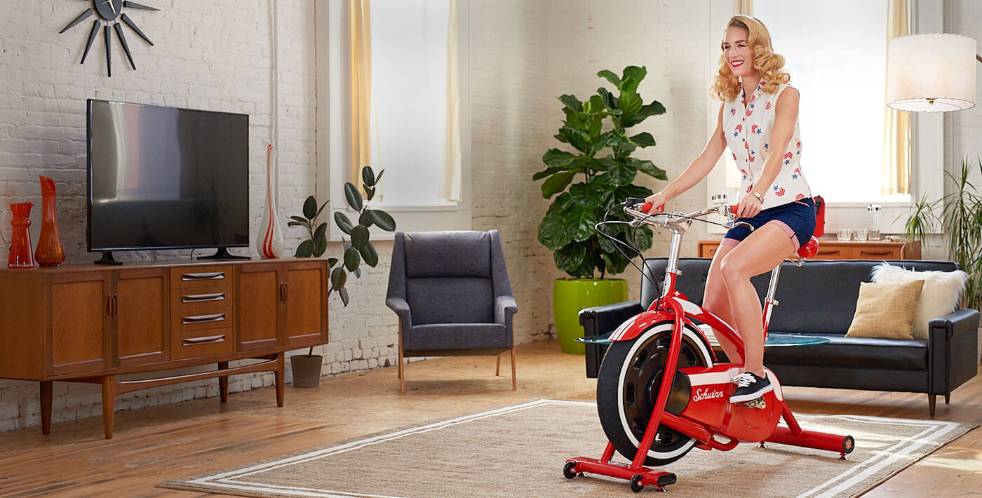 Woman on vintage exercise bike