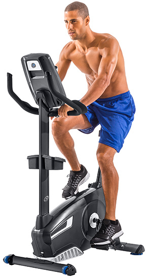 man on a Nautilus upright exercise bicycle